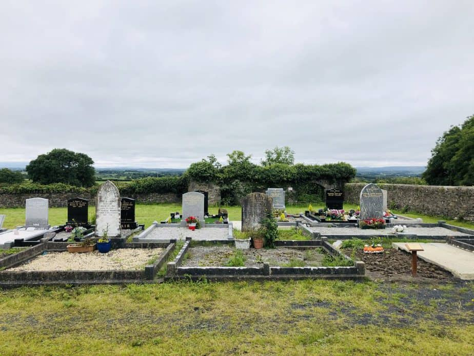 an old irish cemetary surrounded by nature