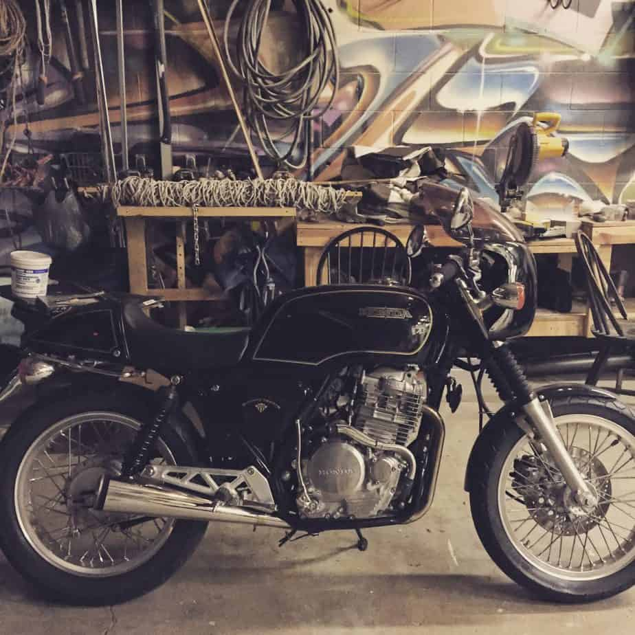 Honda GB 500 motorcycle in a garage with graffiti